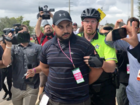 Armed man detained prior to Spencer's speech