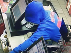 Hoodie-wearing man suspected of armed robbery
