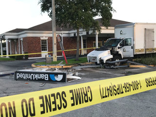 Couple sought after smashing big truck into ATM