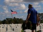 Volunteers place wreaths at Arlington Cemetery