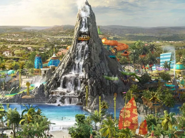 A Picturesque View Of Lagoon And Water Rushing Down The Volcano At Universal S Bay
