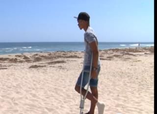 Man bitten by shark on Palm Beach warns others
