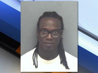 Man arrested after taking photo in restroom