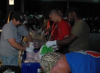 Firefighters prepare turkey for families in need