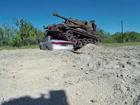Bored? Crush a car in a tank!