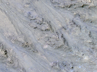 Streaks on Mars may be sand, not water