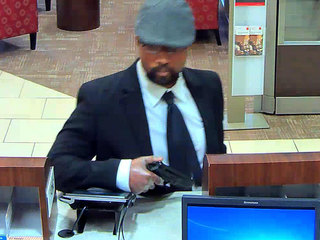 'Business bandit' sought in local bank robberies
