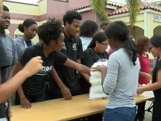 Students hand out meals to those in need