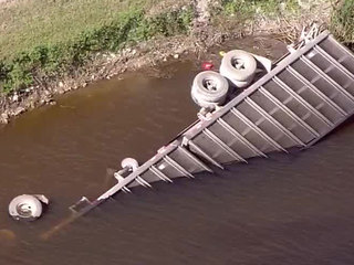 Driver dies after semi plunges into canal