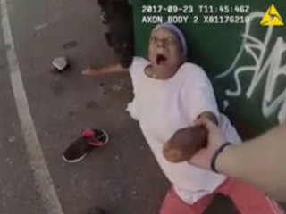 VIDEO: Woman taking out trash attacked by K9