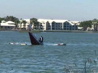 Pilot swims away after crashing plane in lake