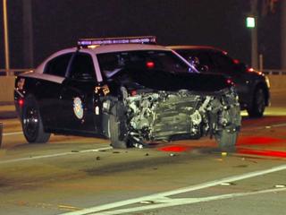 FHP: Driver arrested after striking cruiser