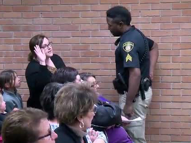 'Stop resisting!' US teacher handcuffed and arrested after questioning pay