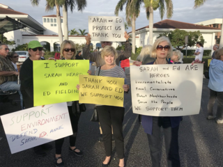 Rally held to support charged commissioners