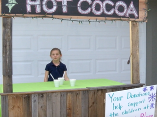 Girl opens hot cocoa stand to help abused kids
