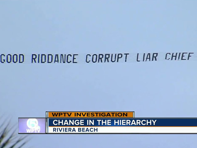 'Good riddance corrupt liar chief' says banner