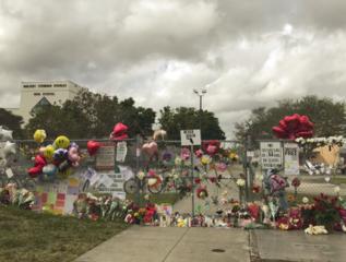 Memorial grows outside Stoneman Douglas