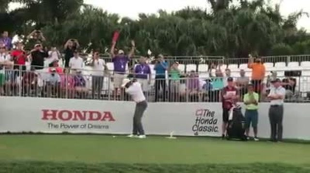Tiger Woods gets in practice swings at Honda Classic