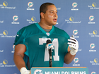 Ex-Miami Dolphin charged with teammate threats