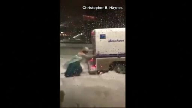 Drag Elsa goes viral for pushing police vehicle stuck in snow