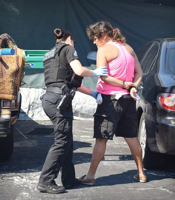 Alicia Elaine Murphy is handcuffed in Delray Beach on Wednesday