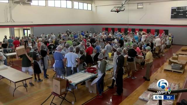 Multi-faith volunteers pack meals in West Palm Beach