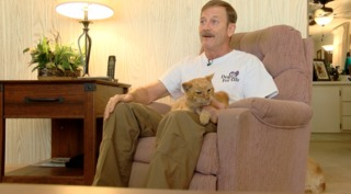 Lost cat reunites with owner after 14 years