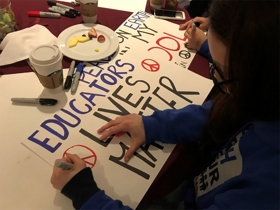 Demonstrators prepare signs for the March for Our Lives in Washington D.C.