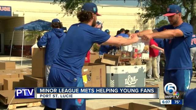 Mets minor leaguer players pack meals for children in need
