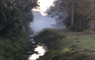 Firefighters watching small brush fire