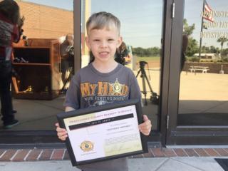 Okeechobee County boy honored for saving mom