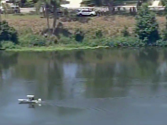 Body found in retention pond where teen yelled 'it bit me'