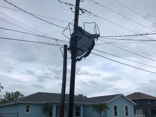 Winds toss trampoline into power lines in Stuart