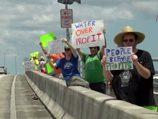 Residents protest toxic algae in Stuart