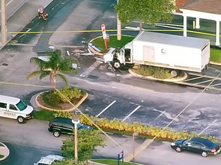 PHOTOS: Large truck crashes into ATM