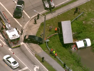 Truck in canal after two-vehicle crash