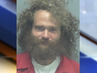 Cops: Naked man dances in fire, threatens them