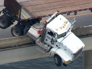 Wreck leaves semi dangling over Florida bridge