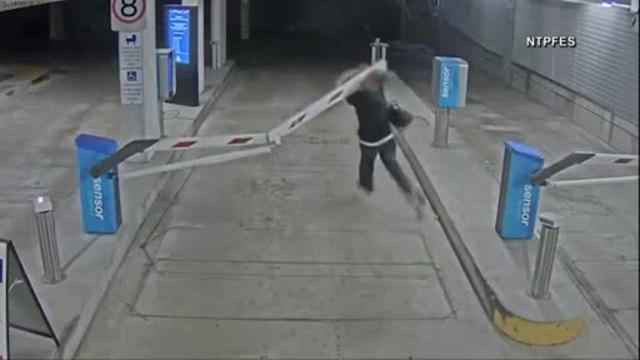 Man on foot plows through parking garage gate in Australia