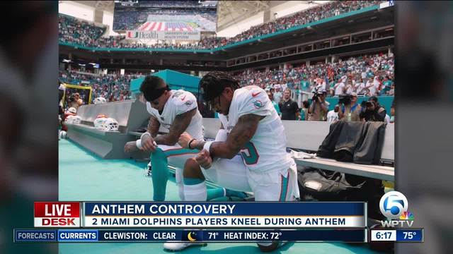 Two Miami Dolphins players kneel during National Anthem