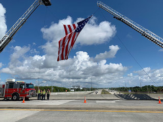 American flags above I-95 welcome firefighters
