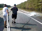 VIDEO: Dead fish washed off NC interstate