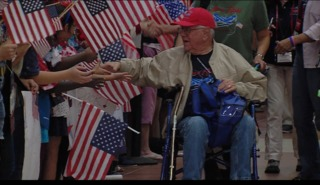 Thousands of people welcome home Honor Flight