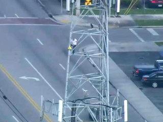 Man climbs 222-foot cellphone tower in Hialeah