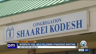 Community standing in solidarity at synagogue