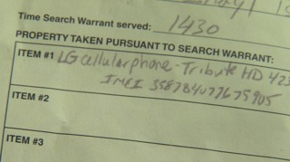 A close up shot of the search warrant investigators gave Moran Jr. when they seized his cell phone.