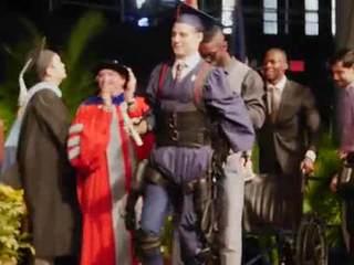 FIU grad walks across stage using exoskeleton